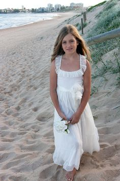 I think this is the perfect flower girl dress for a beach wedding ...