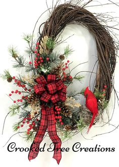 Welcome in the holiday season with this beautiful design from Crooked Tree Creations. Assembled on a 21 handmade wispy birch base, you will find a lush assortment of snowy pine boughs and rustic woodland foliage. Matte red berries, caramel colored fillers, snow tipped pine cones