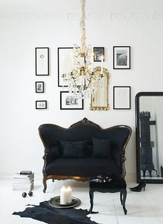 I love the frames on the wall, and that black couch-beautiful!