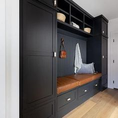 Black and White Mudroom with tan and Orange Rug - Transitional - Laundry Room