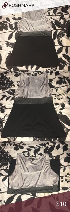 Express Gray and black color block top This tank top is in really good condition. It is moderately 'stretchy'. The top body and waistband is 100% polyester. The bottom body (black section) is 57% cotton, 38% modal, and 5% spandex. No holes or stains. Super cute to wear out or pair with leggings! Express Tops Tank Tops