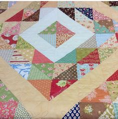 This beautiful quilt is an original design and made with a large variety of fabrics designed by Fig Tree and Company. The background fabrics are also Fig Tree solid fabrics - ivory and pale caramel.  The quilt measure 97.5 square (246.38 cms square) and there is a reasonable overhang on a queen-size bed. The quilt has been professionally quilted and the Twisted Tatting design shows up well in the close-up photo. All fabrics are 100% cotton and the batting is 100% cotton. The backing is from…