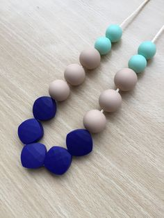 Silicone teething necklace by HappyBabyGums on Etsy