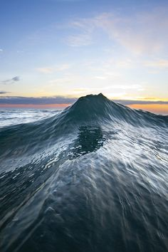 "An amazing ""Sea Mountain"" appears just for a split second, as two waves collide off the coast of Oahu by Sean Davey"