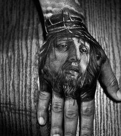 Dark Black And Grey Jesus Face Hand Tattoo For Men