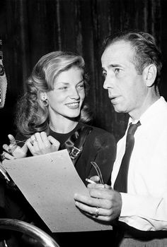 Lauren Bacall and Humphrey Bogart perform an adaptation of ''To Have and Have Not'' on the CBS radio program 'Lux Radio Theatre,' at the Ricardo Montalban Theatre in Hollywood, California. October 14, 1946. ☚
