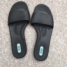 OKA-B Grace Sandals Black OKA-B sandals. Gently used but still in great condition. Spring is here and summer is around the corner you need to start thinking about new footwear! Slip on into the perfect fit of these go-to comfort designed slides with ergonomic foot bed and an easy fit that feels custom made for you. OKA-B Shoes Sandals