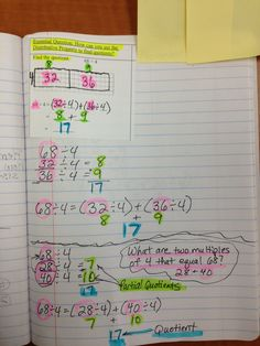 Math journal page using the distributive property to find quotients (division).