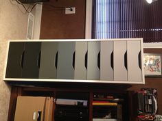 IKEA alex drawers painted ombre black. amazing