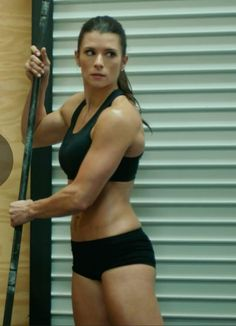 DANICA SHOWS MUSCLES -c5o