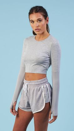 Pair the Nikki Blackketter Season 2 Drop Back Crop Top with the Retro Shorts for the ultimate gym wear combination. Coming soon in Light Grey Marl. #gymoutfits