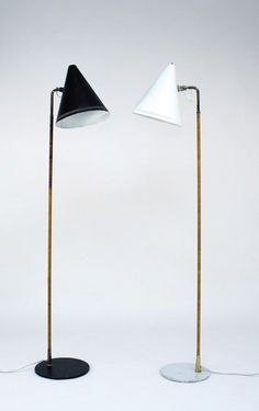 Paavo Tynell. Pair of floor lamps, designed in 1954. H.