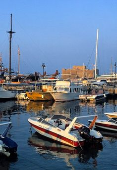 Paphos harbour is overlooked by Paphos castle in the distance. Cyprus
