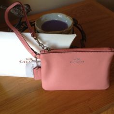 """Coach wristlet in Pink Authentic Pink Coach Wristlet                                                 Dimensions 6 1/2"""" x 4 1/2"""".                                      Two Pockets on each side.                                  Including Authenticity card and care instructions.                                                             Perfect gift for Mother' s Day Coach Bags Clutches & Wristlets"""