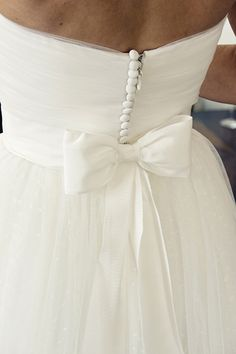 Buttons and a bow - a sweet wedding gown combination. Bell, Wedding Dressses, Tulle Skirts, Button, Bow Back Wedding Dress, The Dress, Bows, Bow On Wedding Dress, Wedding Dress Bow Back