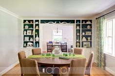 YHL dining room- love the built ins with the turquoise backing.