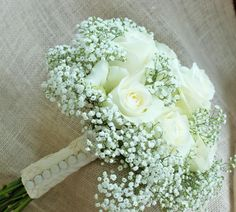 Brides bouquet, white roses and baby's breath with material from her grandmothers wedding dress for stem wrap
