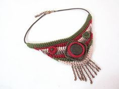 An ethnic/tribal/Native American style crocheted necklace in high quality cotton in the tones of burgundy, forest green, pale pink and brown.