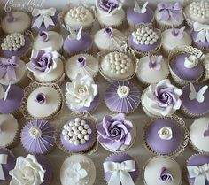 Lilac and white cupcakes by Cotton and Crumbs