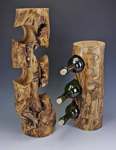 These wine bottle holders are diverse, ranging from vertical stumps topped with divots to house pint/sipping glasses, to horizontal logs cut with grooves to hold bottles/glasses/candles upright