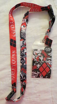 This lanyard is an officially licensed product featuring different artwork on each side of the fabric. Features: - Two Different Prints on the Fabric - Harley Quinn's Diamond Logo Charm - Plastic Inse