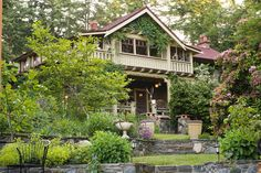Instead of concrete porch make tiered, raised beds full width of house, 3 levels for easily stepping up and down.