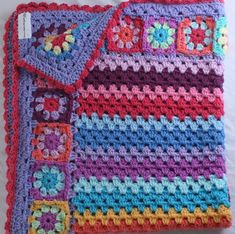 Very pretty Granny Square border and granny stripe baby blanket by ChocolateDogStudio.  I really like the colors on this one!
