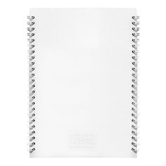 The journal as art object. It's spiral bound on both sides, preventing opening. In order to put pen to paper, the user must rip one side of the cover and so on to release the pages. Maison Martin Margiela