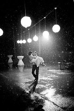Dancing in the rain / wedding