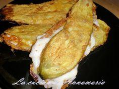 Melanzane indorate e fritte ripiene di provola, ricetta gustosa