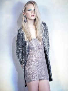 """Hit the glitz in faux fur, sequins, and all things that shimmer. With shimmery sequin dresses, dressy jumpsuits, fab faux fur & more - you""""re never staying in! Fashion Models, Fashion Beauty, Womens Fashion, Holographic Dress, Jumpsuit Dressy, Runway Models, Lace Tops, Dress Me Up, Sequin Dress"""