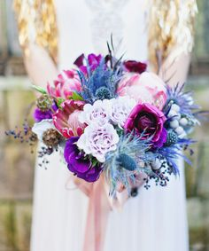purple and blue bouquet with protea