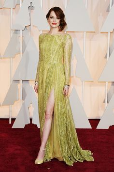 EMMA STONE in ELIE SAAB – Emma Stone showed off some leg as well in a green Elie Saab Haute Couture gown. Her side-swept curls gave a 1920s vibe to the look.