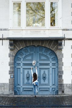 Throwing my hat in front of a stunning old door in Tournai, Belgium that reminds of the famous Parisian doors Chunky Cardigan, Blue Skinny Jeans, Architecture Details, Art History, Parisian, Belgium, Bliss, Travel Photography, Hat
