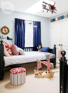Bunk beds in a matte black finish were separated into twin beds in the boys' bedroom. The predominantly blue scheme is enlivened with hits of bright red thanks to Michelle's fabric choices and designer Jennifer Wellman's advice.