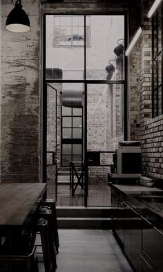 bricks and black kitchen
