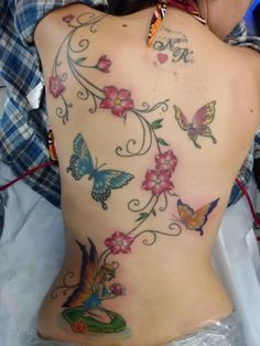 Tattoos on back Vine Tattoos, Foot Tattoos, Sexy Tattoos, Body Art Tattoos, Sleeve Tattoos, Tatoos, Butterfly With Flowers Tattoo, Butterfly Tattoos For Women, Butterfly Tattoo Designs