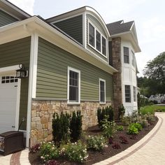 Combining Colonial Tan Natural Stone With Olive Green Siding Traditional Exterior Boston Sidinghouse Paint