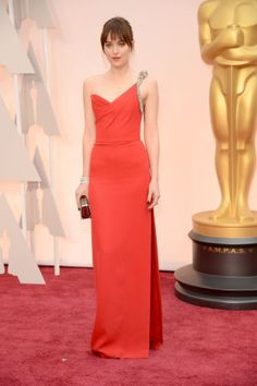Johnson is red hot in a one-strap Saint Laurent gown at the Academy Awards.