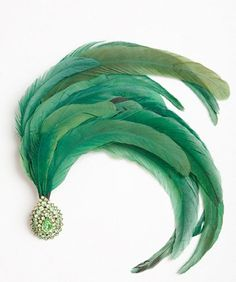 Green feather hair ornament.
