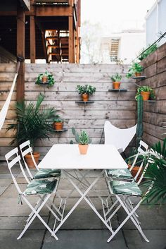 Steal This Look: A Garden Terrace in South Boston: Gardenista Featuring Bistro Chairs and Table in Cotton White - http://www.jardin.co.nz/collections/bistro/
