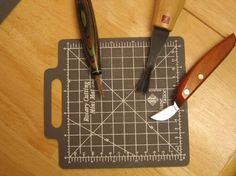 """Quick Tool Honing  From Faye Burden, Madisonville, Ky.    Before I started carving, I used a June Tailor self-healing mat when cutting quilt squares with a rotary cutter. After cutting for a long time, I realized that my cutting blade was staying sharp; apparently the self-healing mat was abrasive enough to sharpen the blade.    I tried it with my carving tools and it worked well. I didn't need to apply any honing compound, water, or oil to the mat. Just make a few cuts into the mat with your tool to quickly touch up the edge. I keep a 5"""" by 5"""" mini mat in my tool bag so I can use it anywhere."""