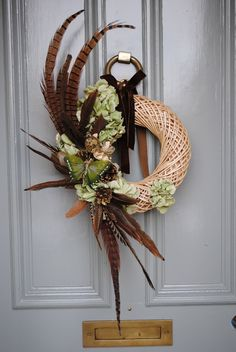 Willow wreath with pheasant feathers and dried by BabylonFlowers, Feather Wreath, Feather Crafts, Christmas Flower Arrangements, Floral Arrangements, Autumn Wreaths, Holiday Wreaths, Christmas Tree Toppers, Christmas Decorations, Willow Wreath