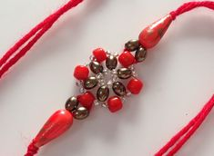 how to make beaded rakhi (bracelet) Diy Bracelets How To Make, How To Make Earrings, Diy Earrings, How To Make Beads, Beaded Bracelets Tutorial, Necklace Tutorial, Jewelry Making Beads, Beaded Jewelry, Beaded Necklace