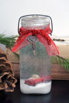 Vintage Snow Globe-Old Red Truck~ Love this! diy - Empty jar with lid Clear epoxy cement* Sealed ceramic or plastic decorative items Glycerine** Glitter, coloured beads, sequins or mini Styrofoam pebbles