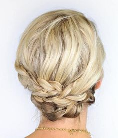 Think you can't have pretty braids? Think again. For hair that's about chin length, you can easily get this braided updo for prom.