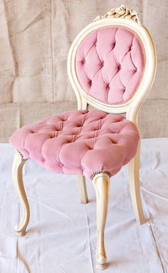 Pink tufted chair...