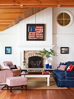 Michigan cottage: A framed American flag from 1837, the year Michigan became a state, inspired this living room's red, white and blue color scheme. More photos from this home: www.midwestliving...