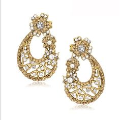 Elegant gold and silver statement earrings Gorgeous Bollywood earrings, great for formal occasions like weddings, prom, sweet 16, etc. Stylish and classy and elegant. Post backs. Accented with rhinestones on a gold tone frame. Jewelry Earrings
