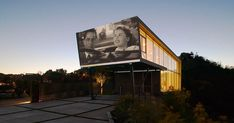This house was designed with a wall space for projecting movies on it making it massively cool